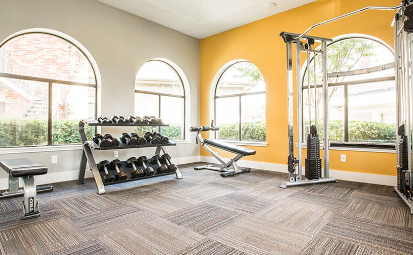 open fitness center with large windows